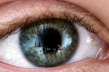 Human eye closeup with reflections