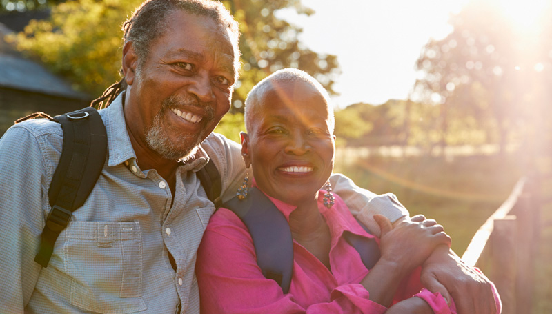 attractive retired couple smiling in the country