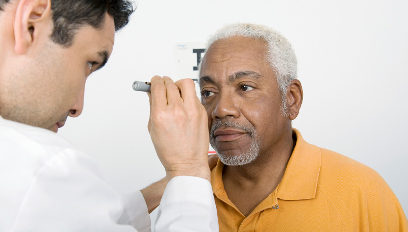 elderly man having his eyes examined