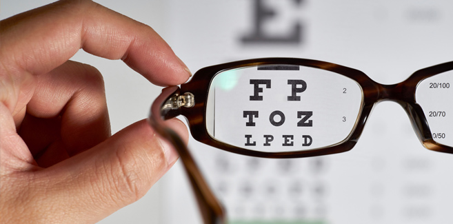 glasses-looking-at-eye-exam-chart
