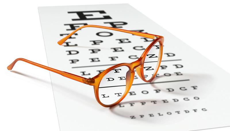 eyeglasses on snellen eye chart