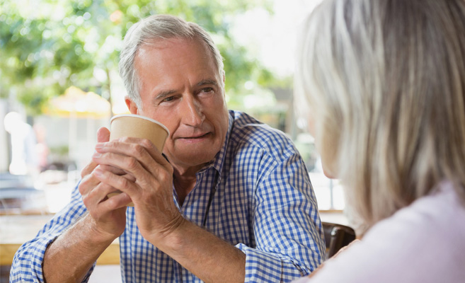 man talking with wife over coffee