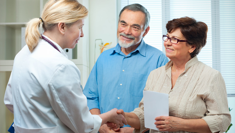 retired couple meeting with doctor