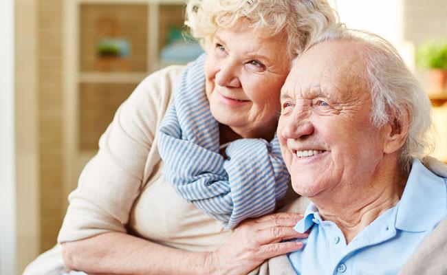older-couple-smiling-living-room