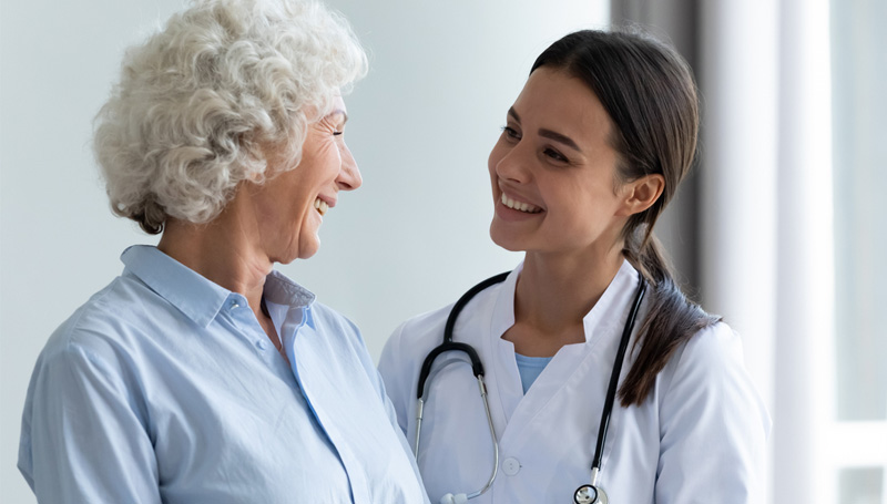 smiling patient talking with eye doctor