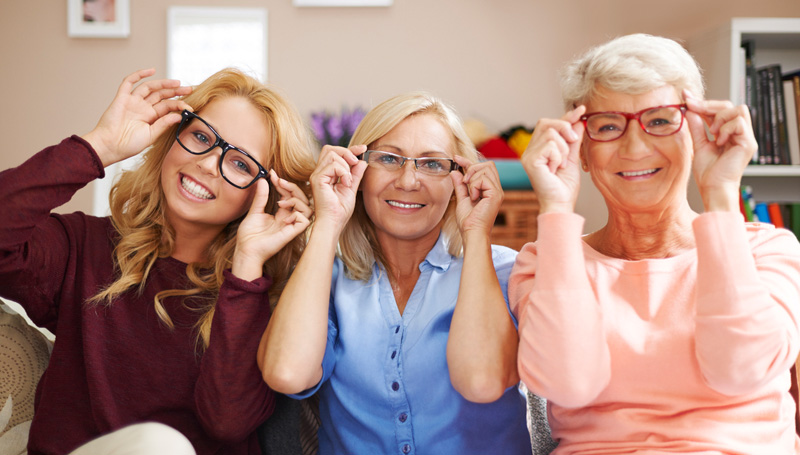 three generations of women smiling in glasses