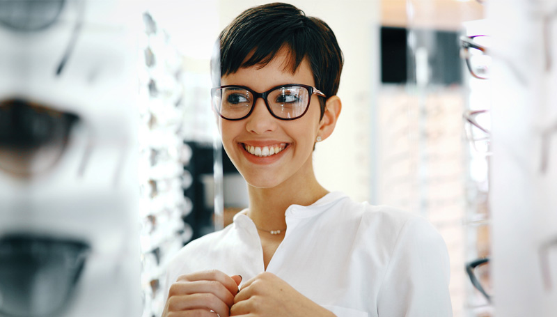 woman trying on new eyeglasses