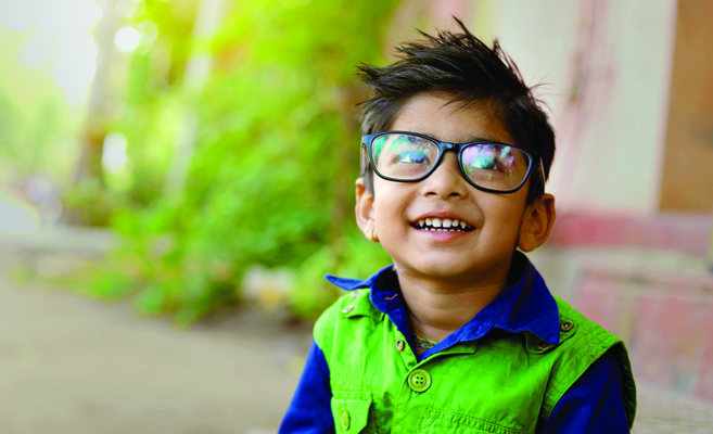 eyeglasses-wearing-child-smiling-outside