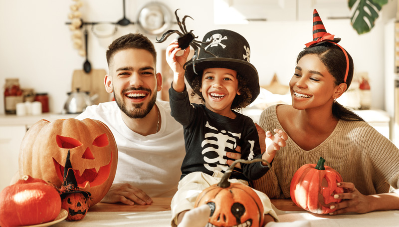 young family with halloween decorations